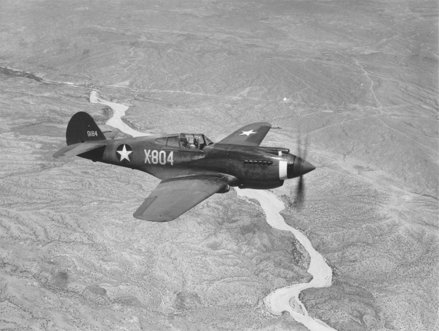 Curtiss P 40 ¾ front view in flight 00910460 023
